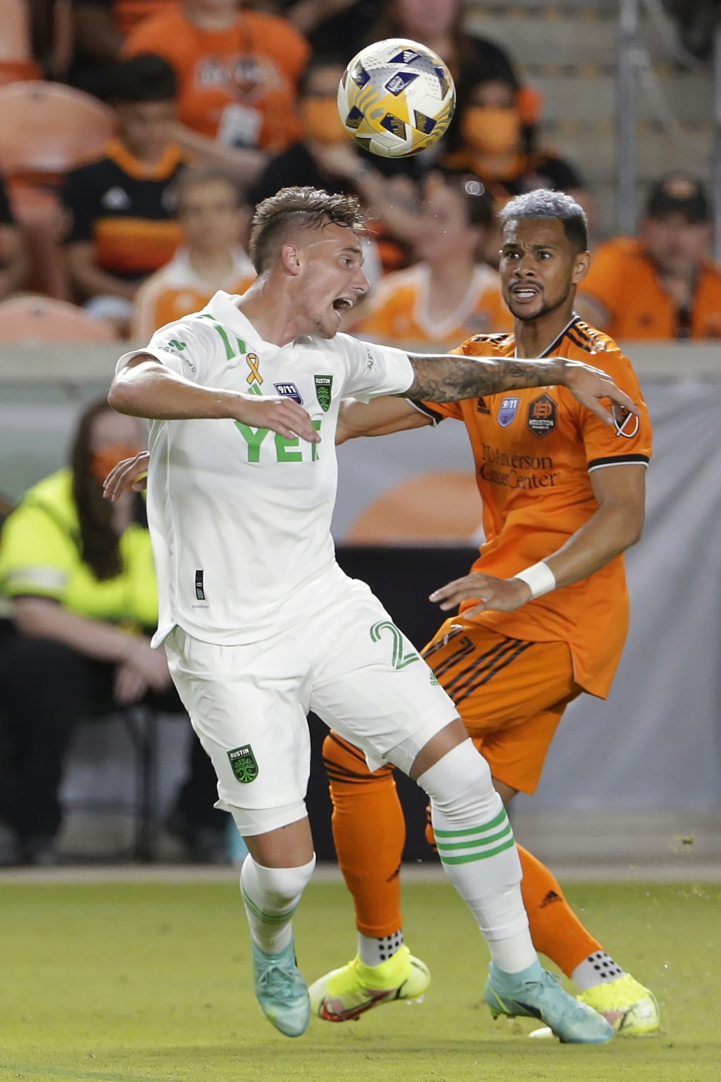 Austin FC defender Zan Kolmanic, left, headers the ball in front of Houston Dynamo forward Ariel Lassiter, right, during the second half of an MLS soc...