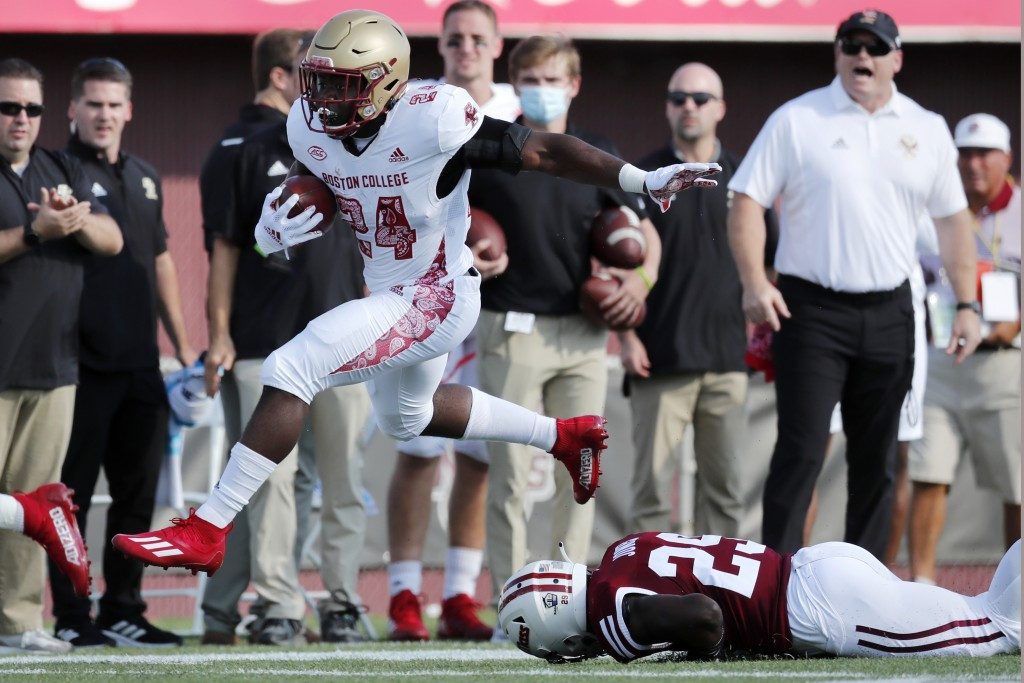 Boston College running back Pat Garwo III (24) evades Massachusetts defensive back Cody Jones (29) during the first half of an NCAA college football g...