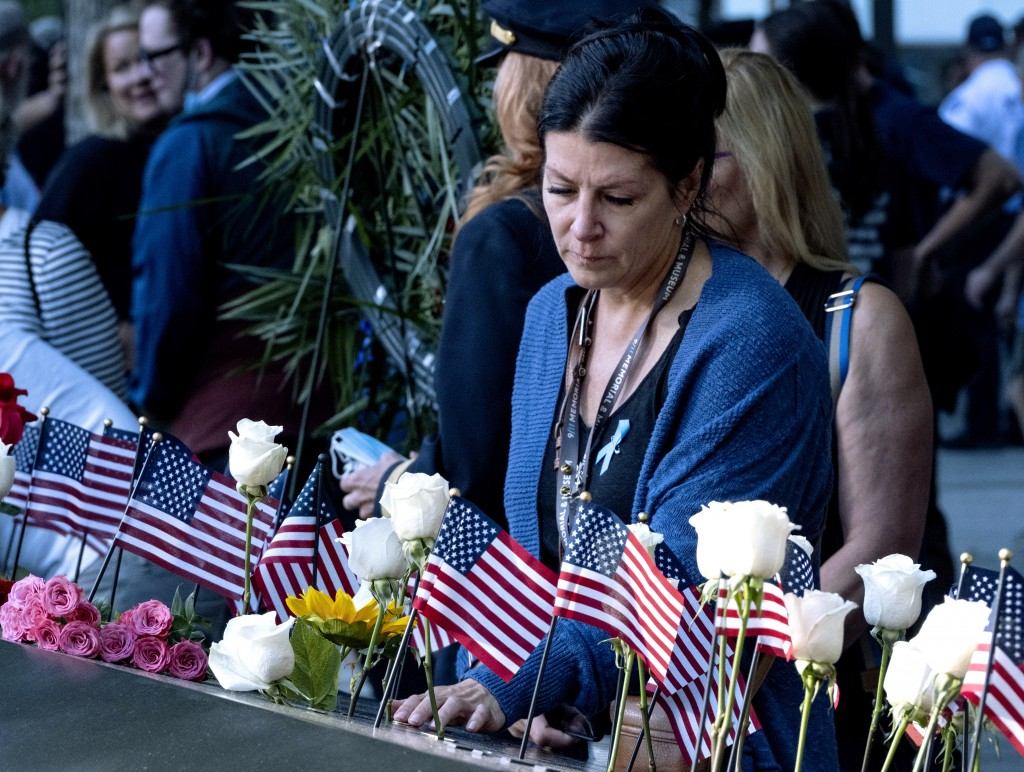 Julie Sweeney Roth, whose husband, Brian Sweeney died when United Airlines flight 175 hit the World Trade Center on Sept. 11, 2001, touches his inscri...