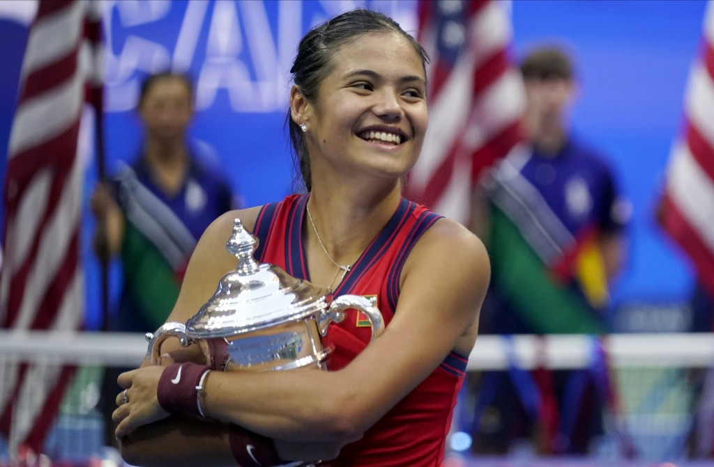 Emma Raducanu, of Britain, holds the US Open championship trophy after defeating Leylah Fernandez, of Canada, during the women's singles final of the ...