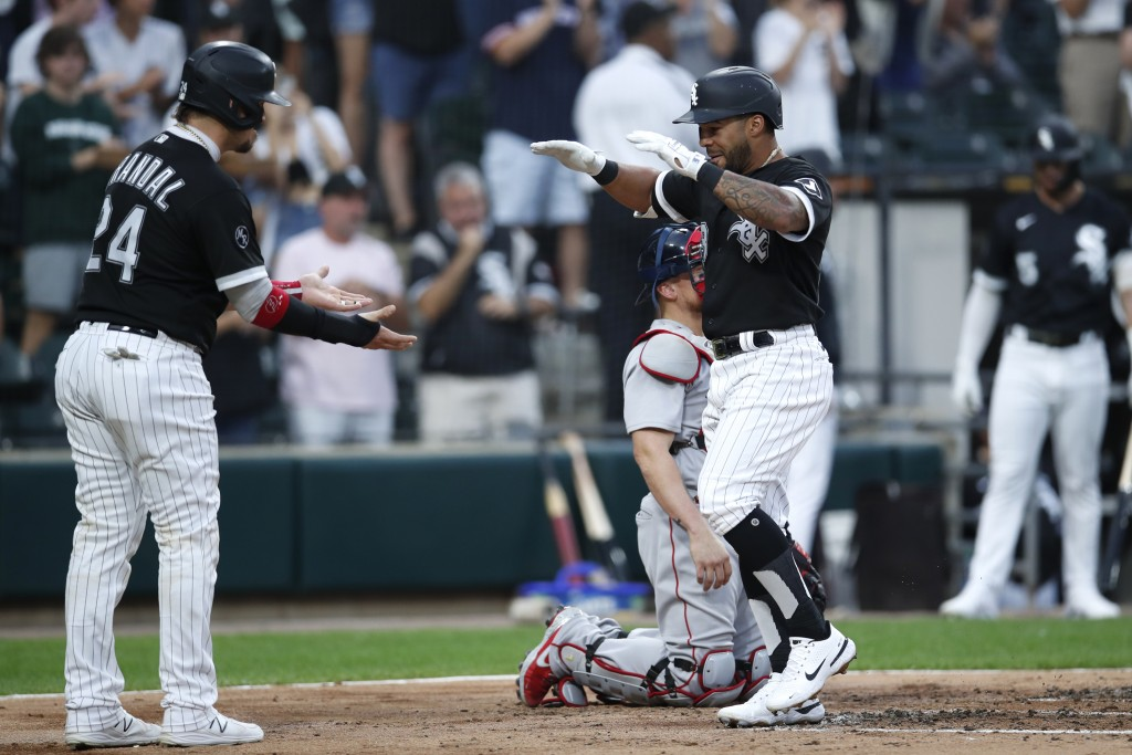 Chicago White Sox's Leury Garcia, right, celebrates with teammate Yasmani Grandal, left, after hitting a two-run home run during the second inning of ...