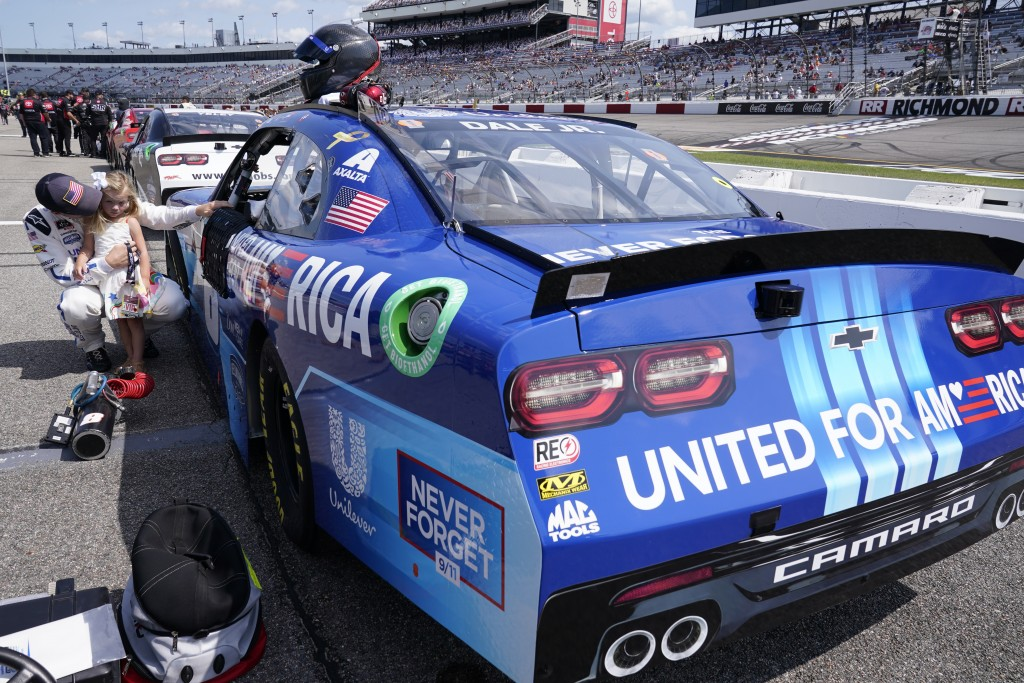 Dale Earnhardt Jr., holds his daughter Isla, 3, during driver introductions prior to the start of the NASCAR Xfinity auto race in Richmond, Va., Satur...