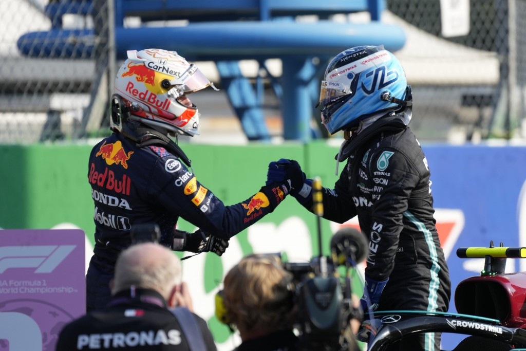 Mercedes driver Valtteri Bottas of Finland, the winner, right, is congratulated by runnerup Red Bull driver Max Verstappen of the Netherlands the Spri...