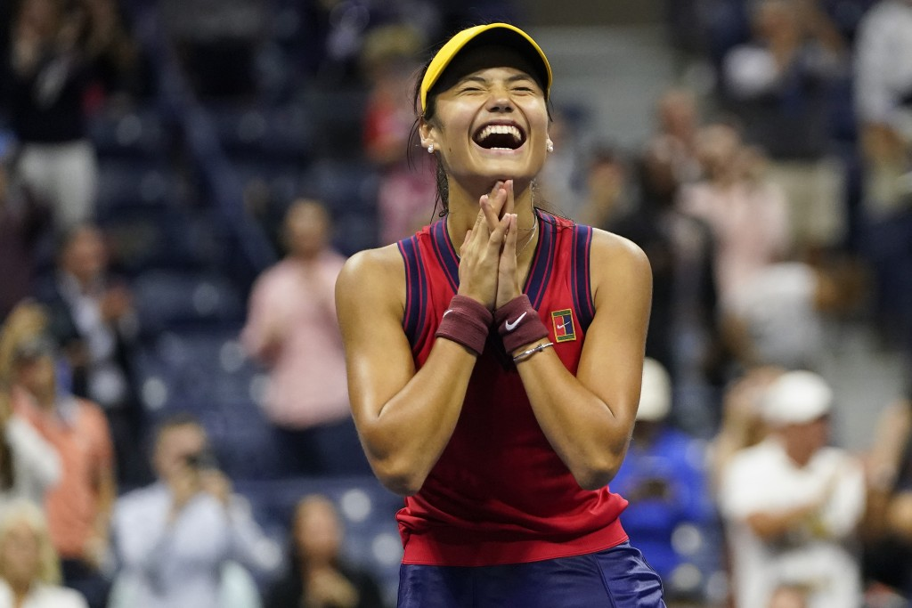 Emma Raducanu, of Great Britain, reacts after defeating Maria Sakkari, of Greece, during the semifinals of the US Open tennis championships, Thursday,...