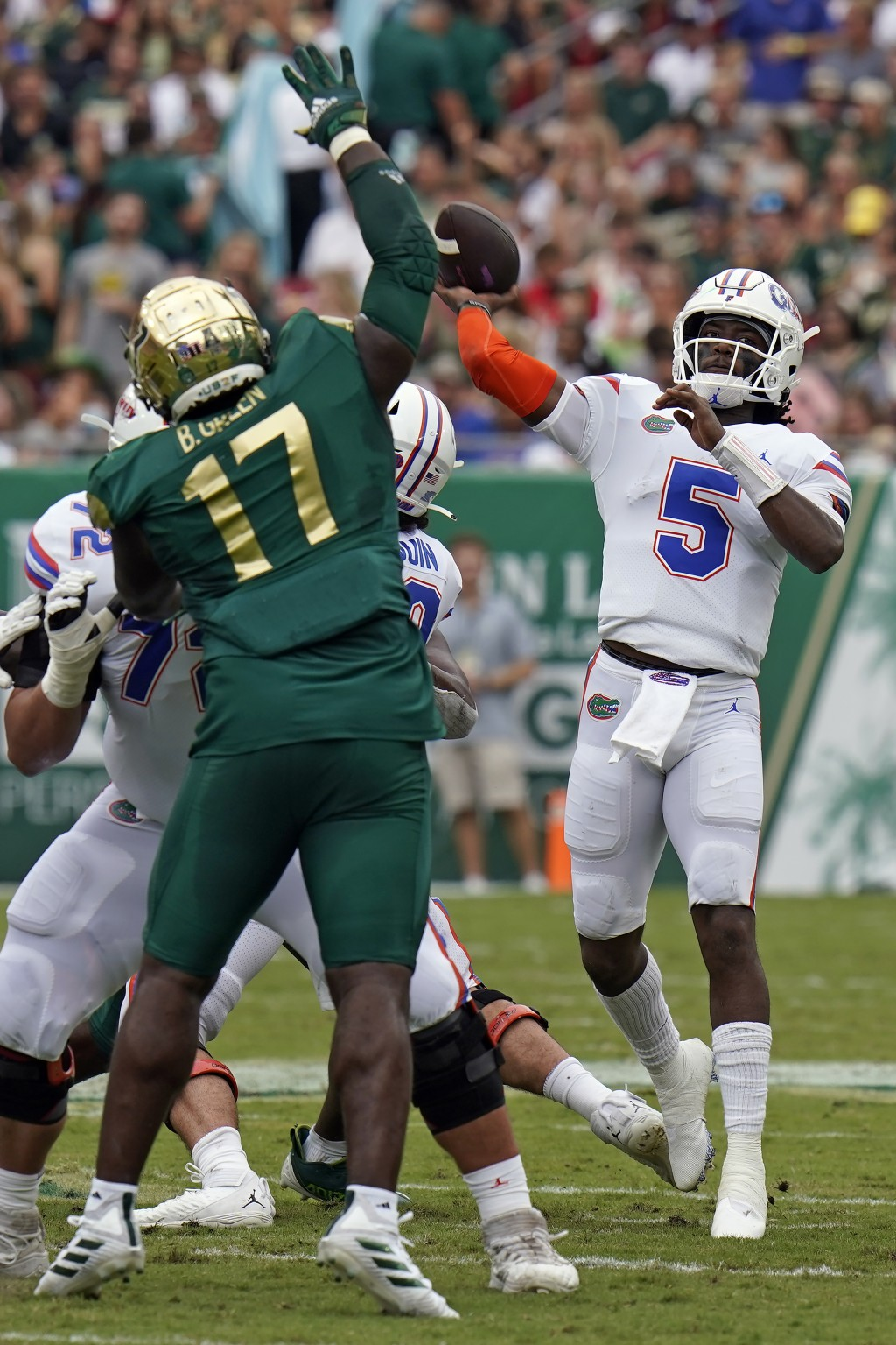 Florida quarterback Emory Jones (5) throws a touchdown pass over South Florida defensive tackle Blake Green (17) during the first half of an NCAA coll...