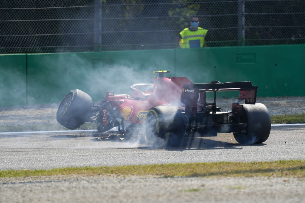 Ferrari driver Carlos Sainz of Spain steers his car after crashing during a free practice at the Monza racetrack, in Monza, Italy , Saturday, Sept.11,...