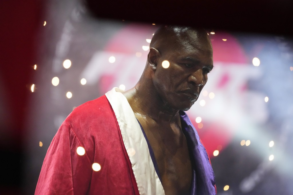 Former heavyweight champ Evander Holyfield walks into the ring for his boxing match against former MMA star Vitor Belfort, Saturday, Sept. 11, 2021, i...