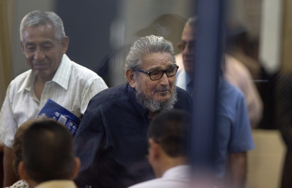 FILE - In this Feb. 28, 2017 file photo, Abimael Guzman, founder and leader of the Shining Path guerrilla movement, center, enters a courtroom at the ...