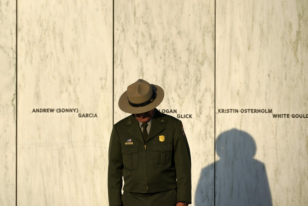 A National Park Service ranger stands in front of the Wall of Names at the Flight 93 National Memorial in Shanksville, Pa. before a Service of Remembr...
