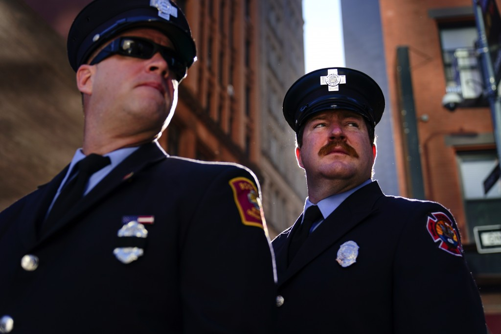 Firefighters from Massachusetts gather with others outside the National September 11 Memorial and Museum during a ceremony marking the 20th anniversar...