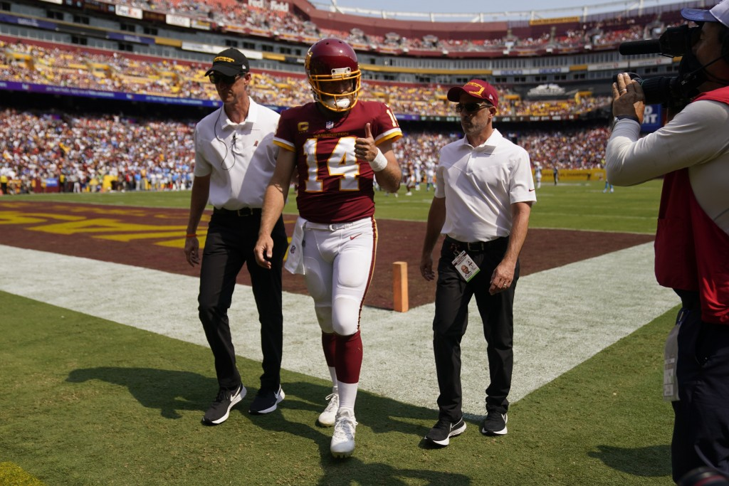 Washington Football Team quarterback Ryan Fitzpatrick (14) gives a 'thumbs-up' as he walks off field after being injured during the first half of an N...