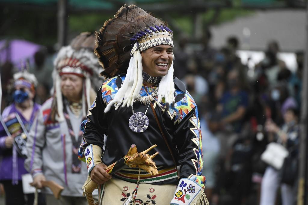 Rodney Butler, Chairman of the Mashantucket Pequot Tribal Nation, participates in the Schemitzun grand entry on Mashantucket Pequot Reservation, in Ma...