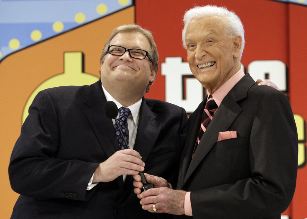 FILE - The Price is Right show host, comedian Drew Carey, left, appears with longtime former host Bob Barker at the CBS Studio Center in Los Angeles o...