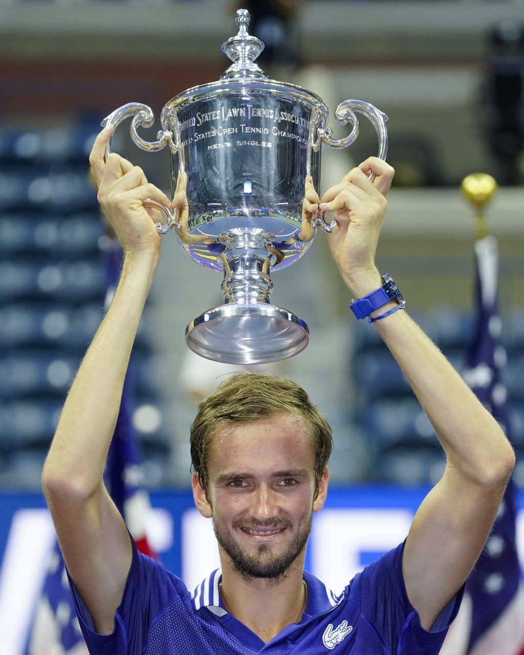 Daniil Medvedev, of Russia, holds up the championship trophy after defeating Novak Djokovic, of Serbia, in the men's singles final of the US Open tenn...