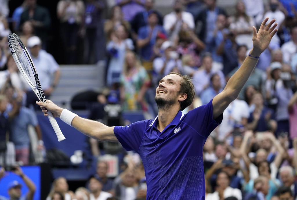 Daniil Medvedev, of Russia, reacts after defeating Novak Djokovic, of Serbia, during the men's singles final of the US Open tennis championships, Sund...