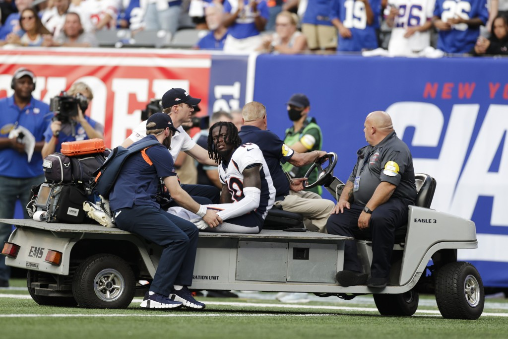 Denver Broncos wide receiver Jerry Jeudy (10) is carted off the field during the second half of an NFL football game against the New York Giants, Sund...