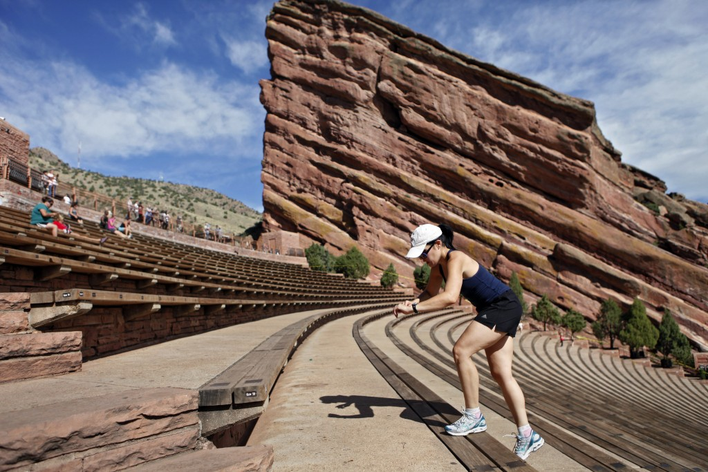 File- In this Sept. 12, 2011, file photo, a woman exercises by climbing the rows of seats at the Red Rocks Amphitheatre near Denver, Colo. Amazon says...