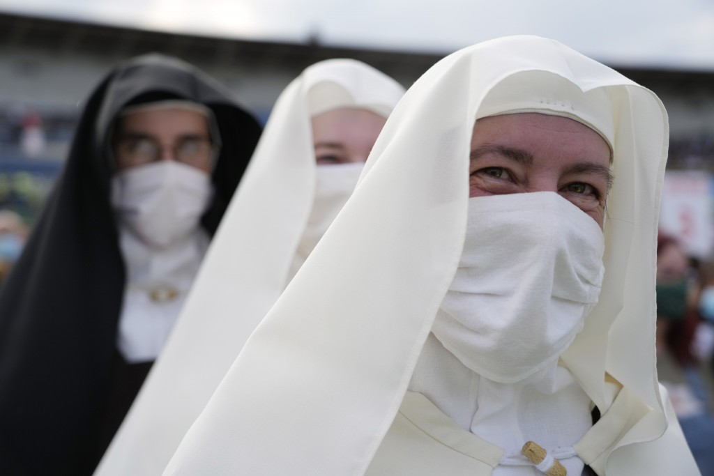 Nuns wait for Pope Francis atLokomotivaStadium inKošice, Slovakia, Tuesday, Sept. 14, 2021. Francis first trip since undergoing intestinal surgery...
