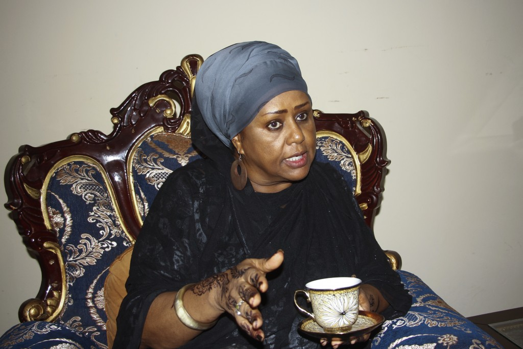 Somali Parliament member Fawzia Yusuf H. Adam discusses with guests at her home in Mogadishu, Somalia Saturday, July 17, 2021. The woman who broke bar...