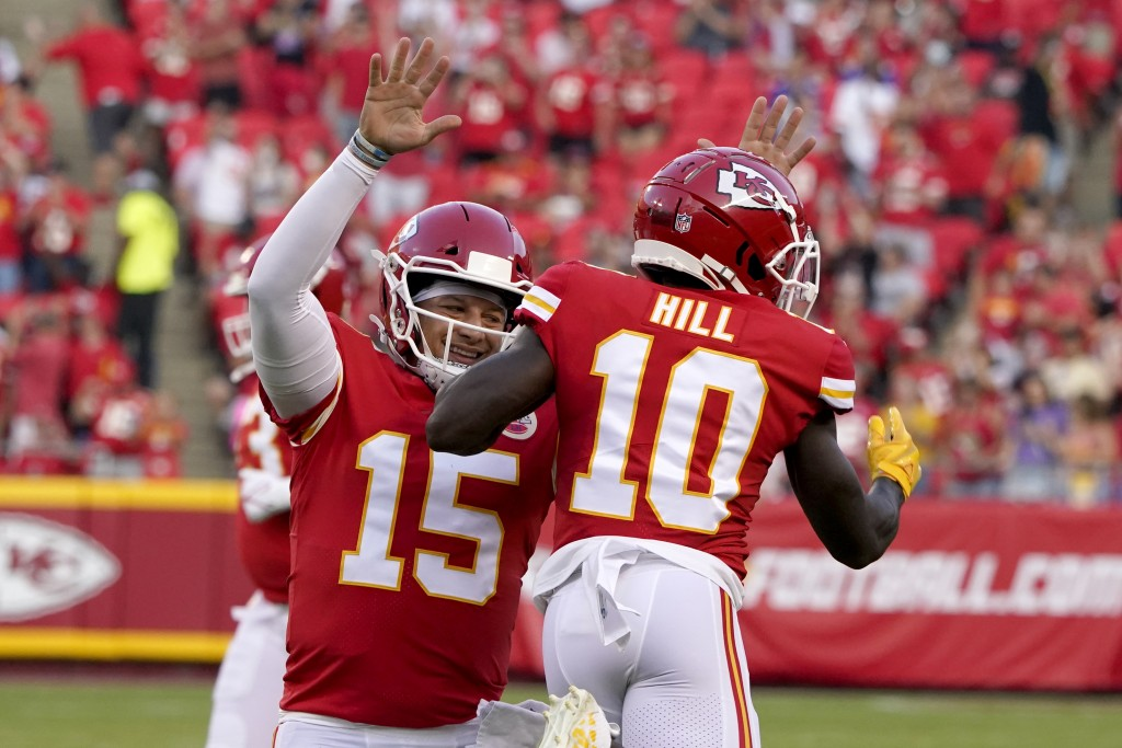 Kansas City Chiefs quarterback Patrick Mahomes (15) celebrates after throwing a touchdown pass to wide receiver Tyreek Hill (10) during the first half...