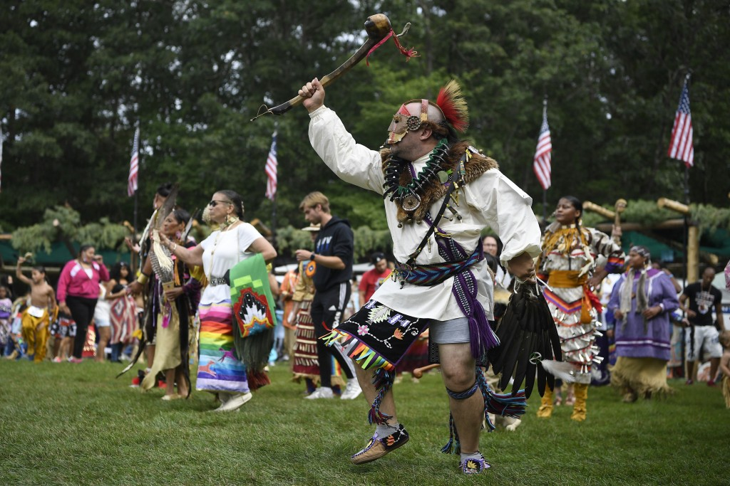 Patrick Littlewolf, of Secaucus, N.J., representing the Tuscarora Tribe, participates in an intertribal dance at Schemitzun on the Mashantucket Pequot...