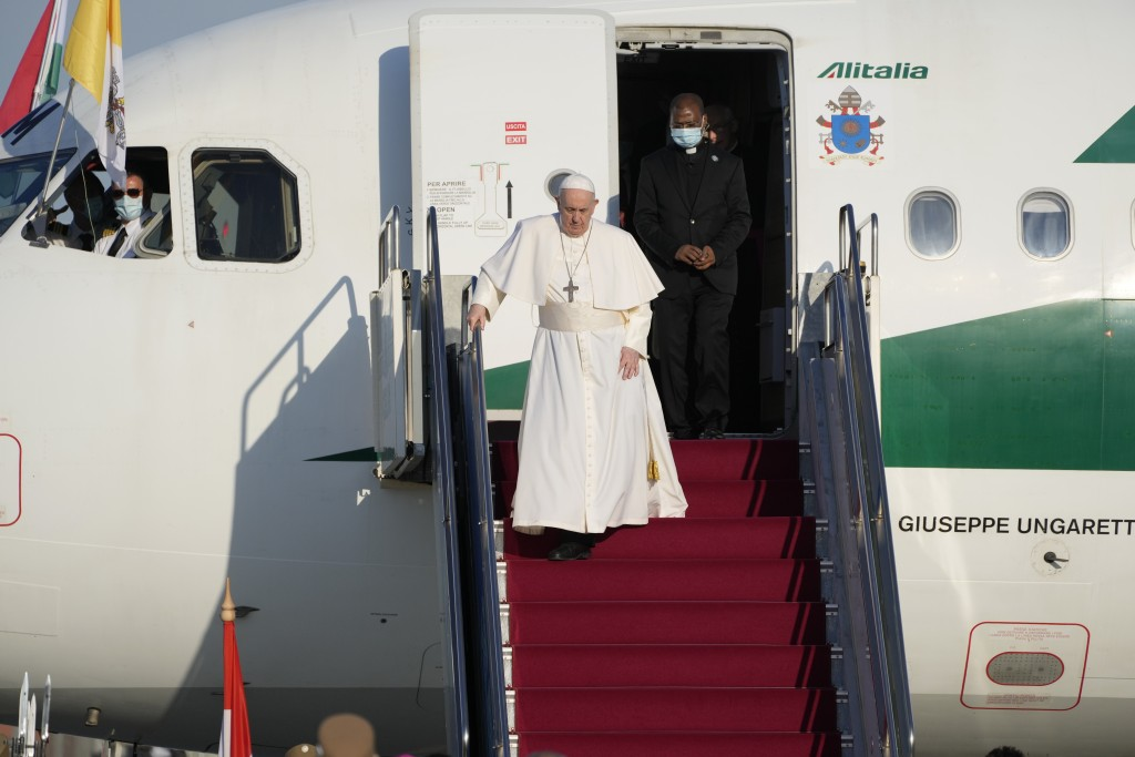 Pope Francis walks down the steps on an airplane as he arrives at Budapest international airport, Sunday, Sept. 12, 2021. Francis is opening his first...