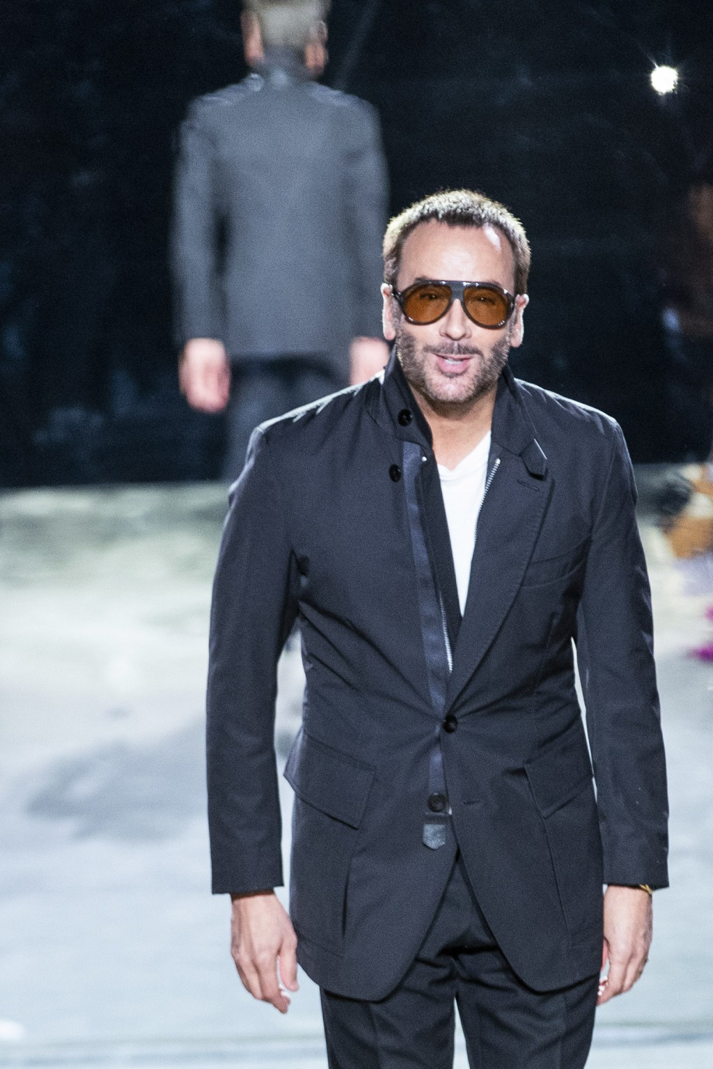 Designer Tom Ford walks the runway at the end of his spring/summer 2022 fashion show at Lincoln Center during New York Fashion Week on Sunday, Sept. 1...