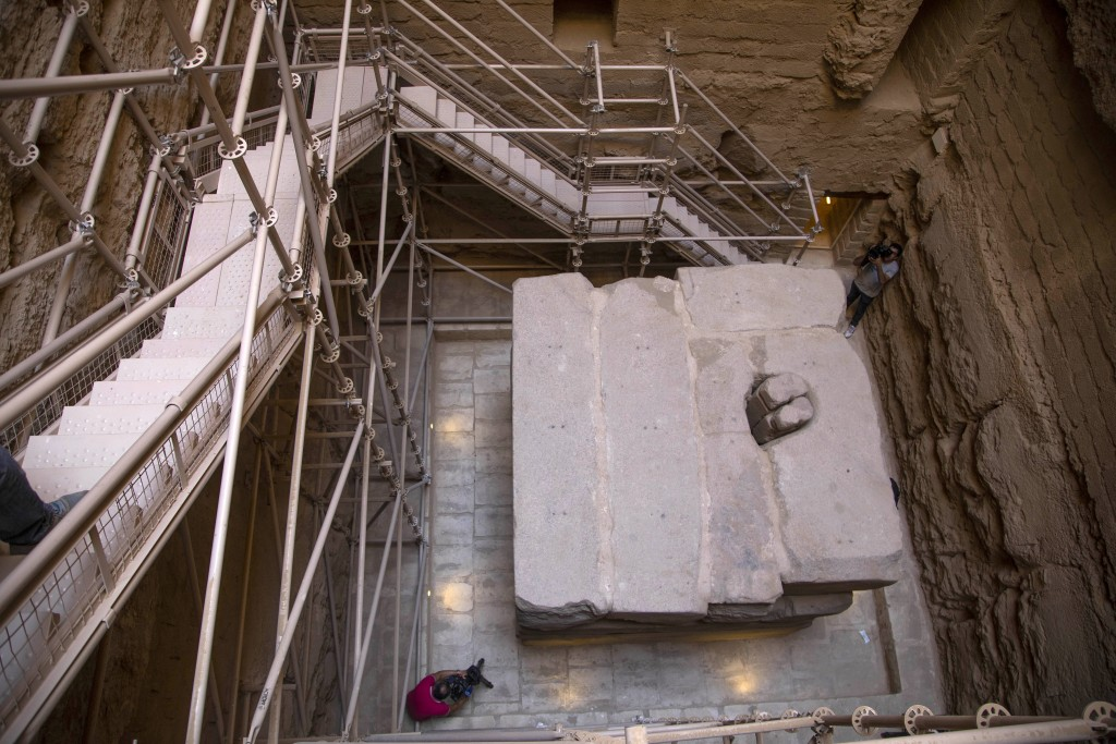 Journalists film the southern cemetery of King Djoser, after its restoration, near the famed Step Pyramid, in Saqqara, south of Cairo, Egypt, Tuesday,...