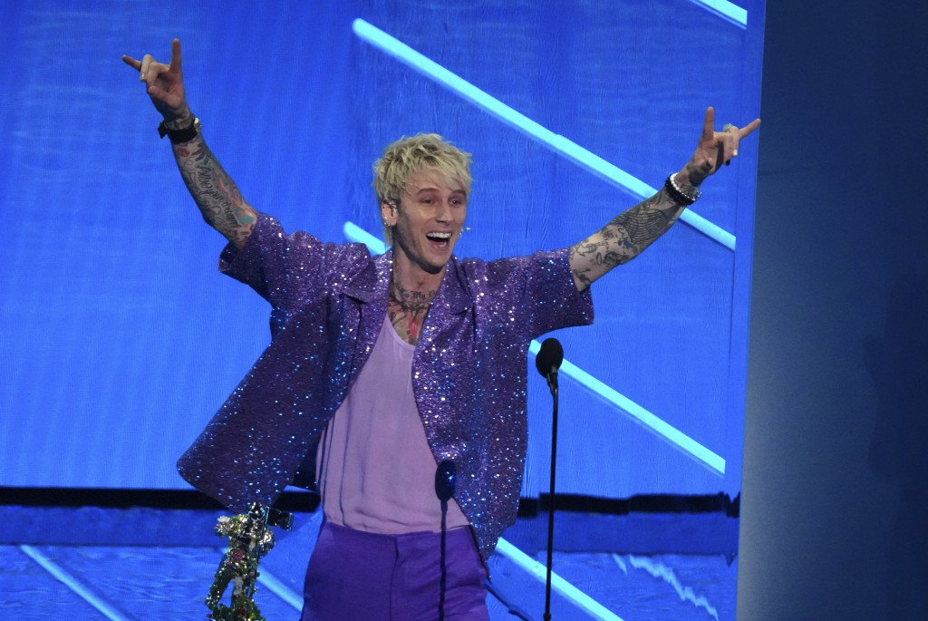 """Machine Gun Kelly accepts the award for best alternative song for """"My Ex's Best Friend"""" at the MTV Video Music Awards at Barclays Center on Sunday, Se..."""