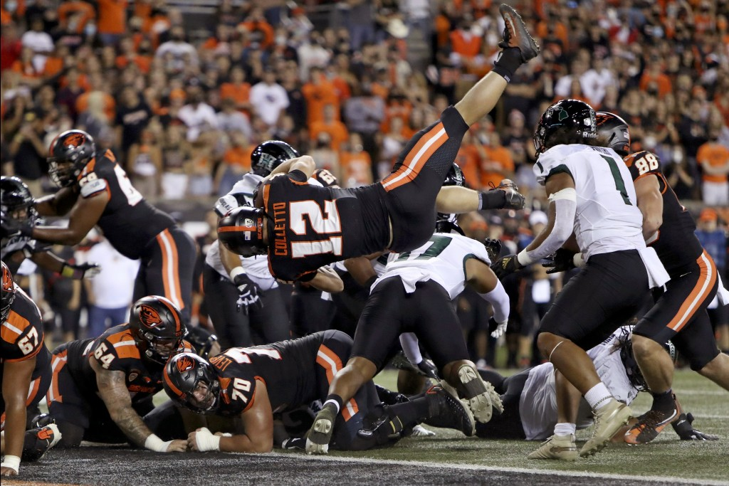 Oregon State inside linebacker Jack Colletto (12) flies backwards into the end zone for a touchdown during the first half of an NCAA college football ...