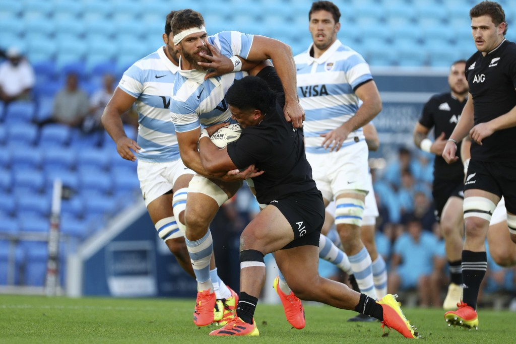 Argentina's Marcos Kremer, left, tackles New Zealand's Asafo Aumua during their Rugby Championship match on Sunday, Sept. 12, 2021, on the Gold Coast,...