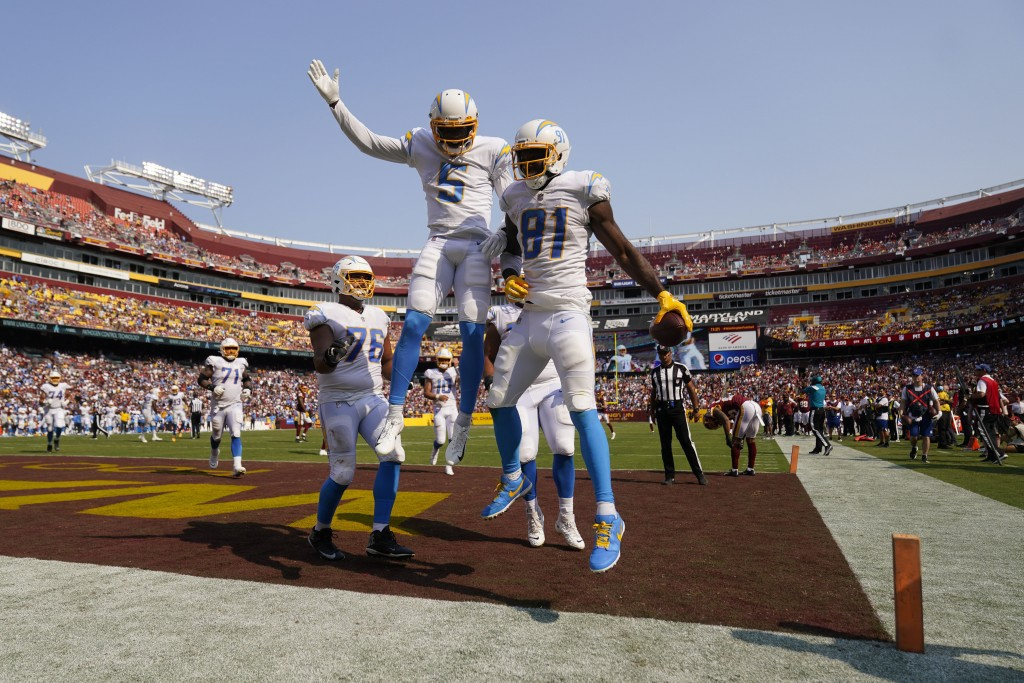 Los Angeles Chargers wide receiver Mike Williams (81) celebrates his touchdown with teammate wide receiver Josh Palmer (5) during the second half of a...