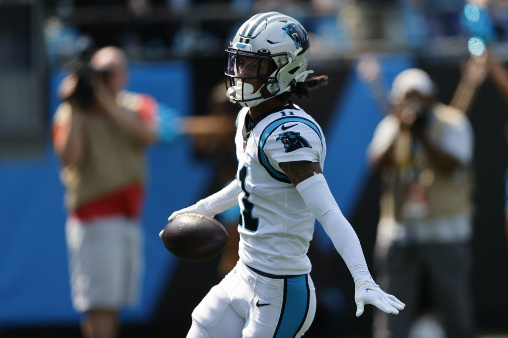 Carolina Panthers wide receiver Robby Anderson celebrates after scoring against the New York Jets during the first half of an NFL football game Sunday...