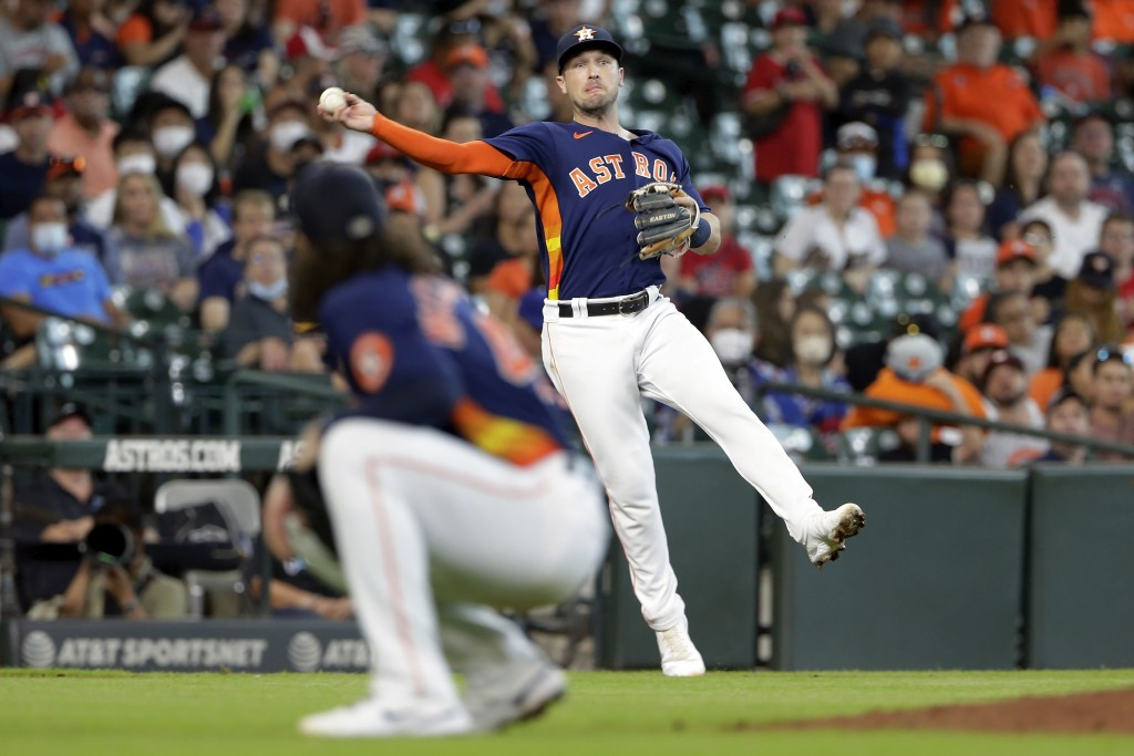 Houston Astros third baseman Alex Bregman throws to first base over pitcher Lance McCullers Jr. for an out against Los Angeles Angels' Kurt Suzuki dur...