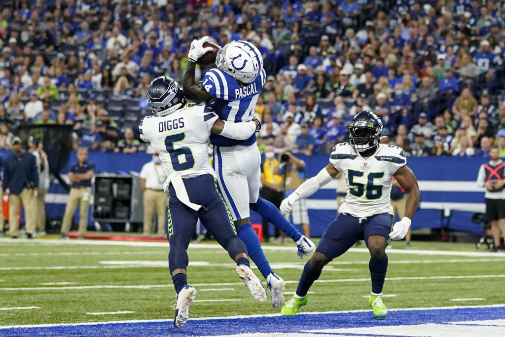 Indianapolis Colts wide receiver Zach Pascal (14) makes catch between Seattle Seahawks strong safety Quandre Diggs (6) and linebacker Jordyn Brooks (5...