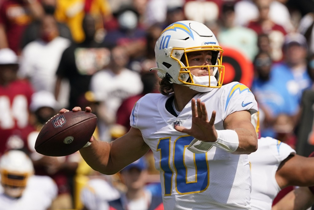 Los Angeles Chargers quarterback Justin Herbert (10) throws a pass against the Washington Football Team during the first half of an NFL football game,...