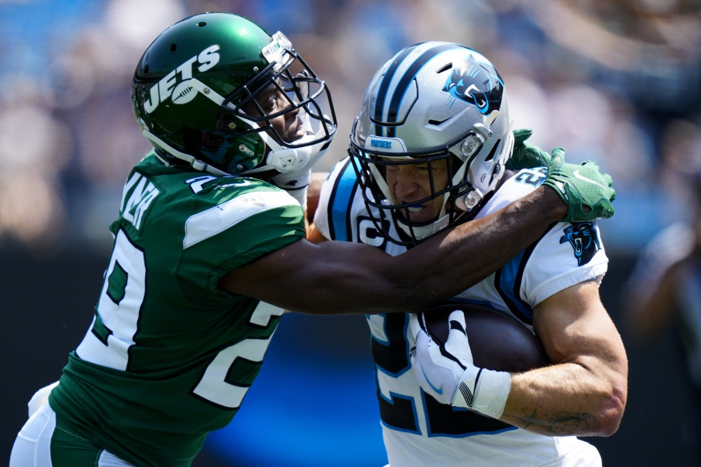 Carolina Panthers running back Christian McCaffrey is tackled by New York Jets free safety Lamarcus Joyner during the first half of an NFL football ga...