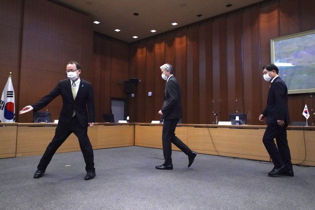Japanese Foreign Ministry's Director-General of the Asian and Oceanian Affairs Bureau Takehiro Funakoshi, left, escorts U.S. Special Representative fo...