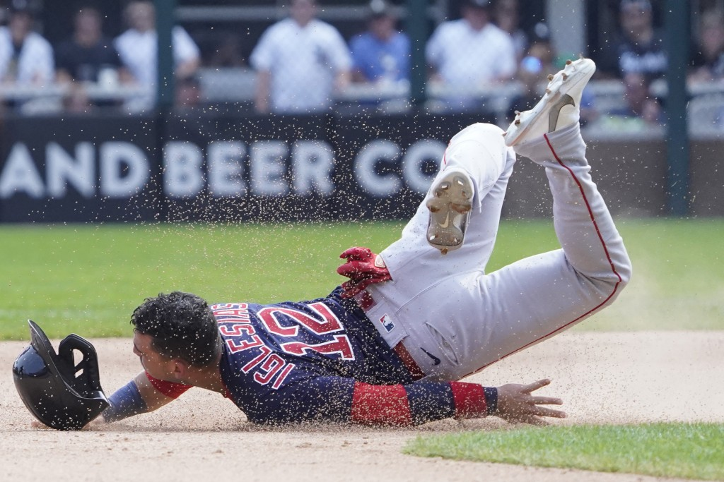 Boston Red Sox's Jose Iglesias (12) loses his helmet as he slides into second base against the Chicago White Sox during the sixth inning of a baseball...