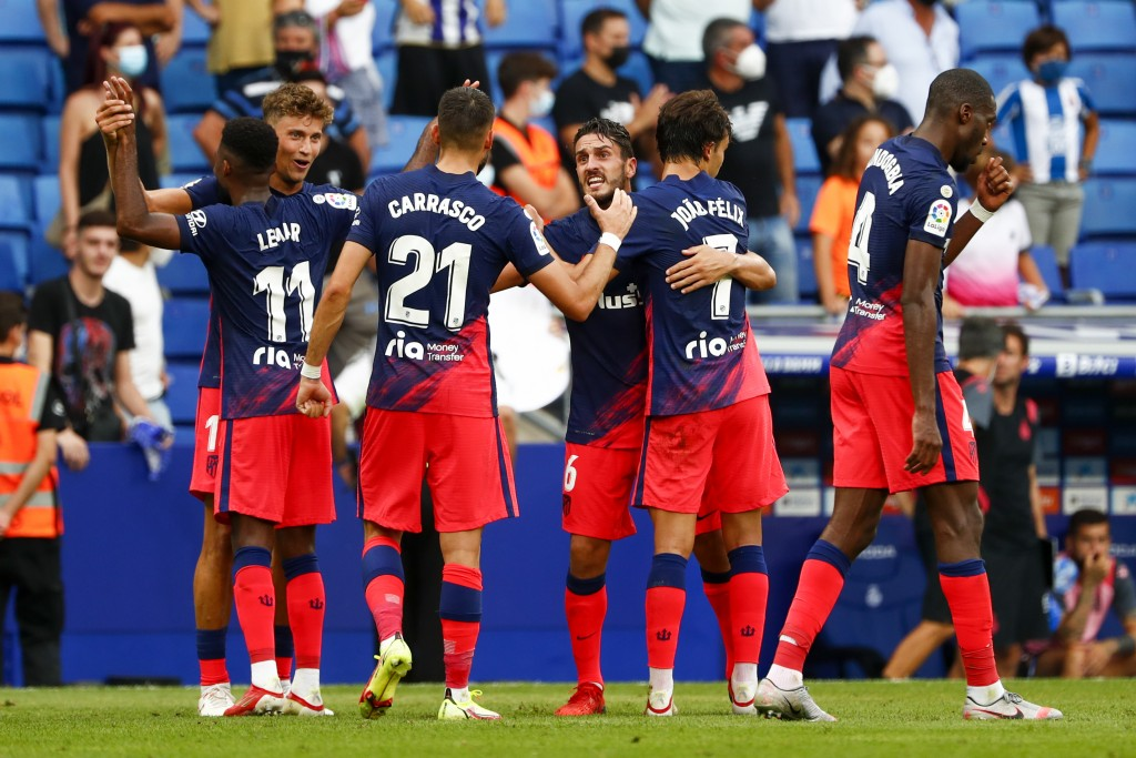 Atletico Madrid's Thomas Lemar, left back, celebrates with his teammates after scoring his side's second goal during the Spanish La Liga soccer match ...