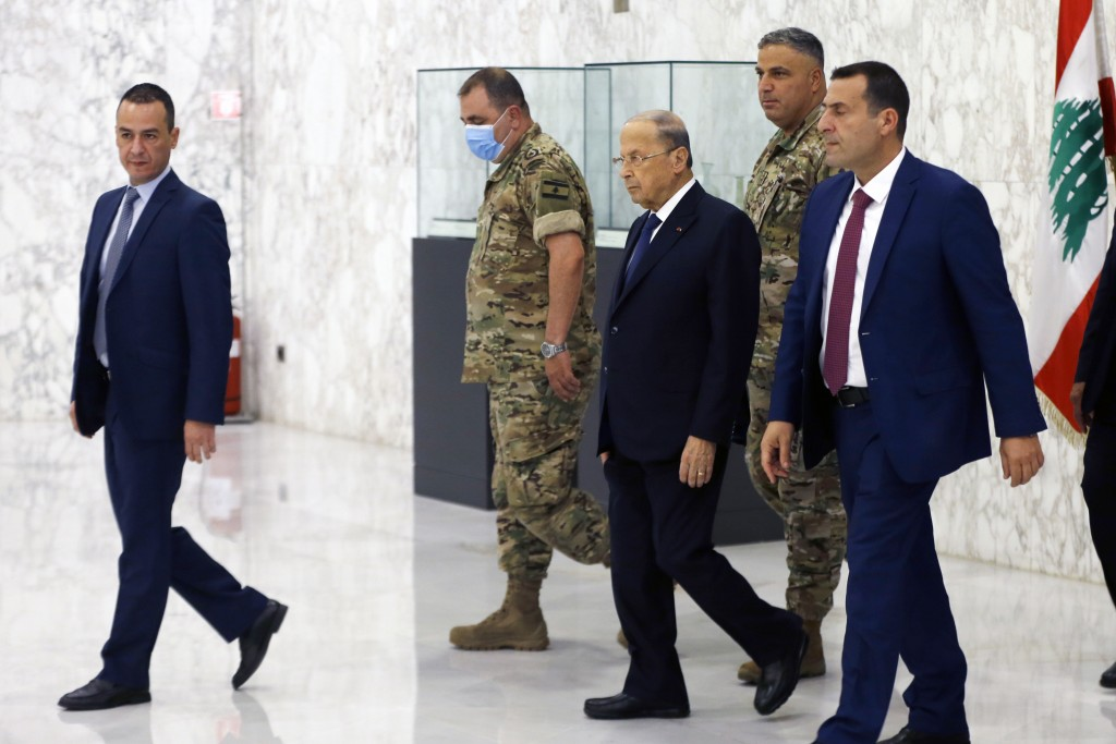 Lebanese President Michel Aoun, center, arrives to attend a cabinet meeting at the presidential palace in Baabda, east of Beirut, Lebanon, Monday, Sep...