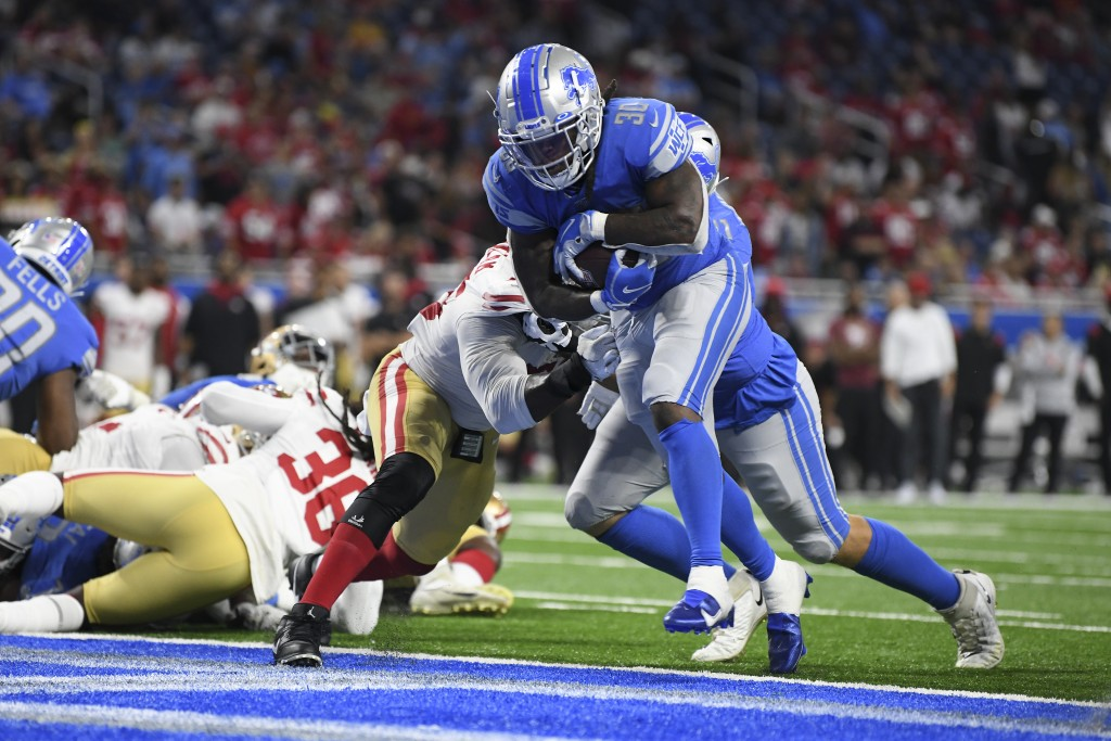 Detroit Lions running back Jamaal Williams (30) runs for a one-yard touchdown against the San Francisco 49ers in the second half of an NFL football ga...