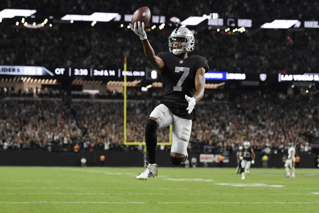 Las Vegas Raiders wide receiver Zay Jones (7) celebrates after scoring a game winning touchdown against the Baltimore Ravens during overtime in an NFL...