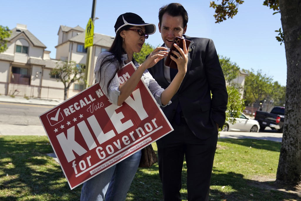 Assemblyman Kevin Kiley, right, of Rocklin, a Republican candidate for governor in the Sept. 14 recall election, speaks with supporter Nancy Jiang dur...