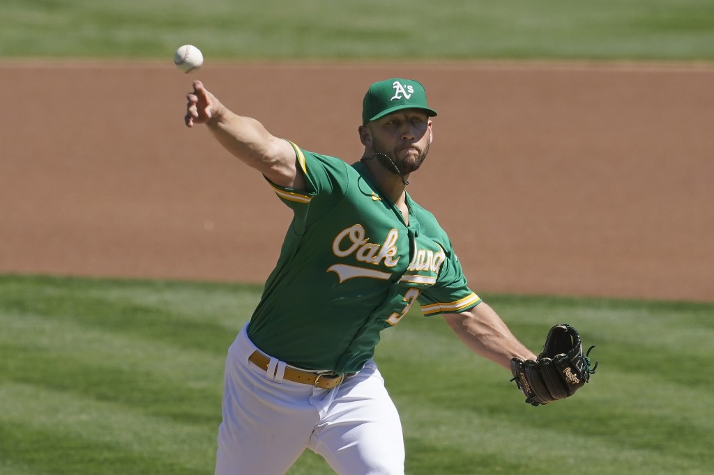 Oakland Athletics' James Kaprielian pitches against the Texas Rangers during the first inning of a baseball game in Oakland, Calif., Sunday, Sept. 12,...