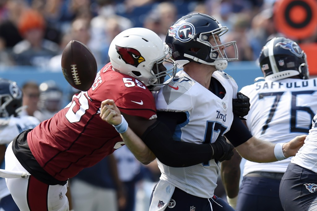 Arizona Cardinals linebacker Chandler Jones (55) sacks Tennessee Titans quarterback Ryan Tannehill (17) and forces a fumble that the Cardinals recover...