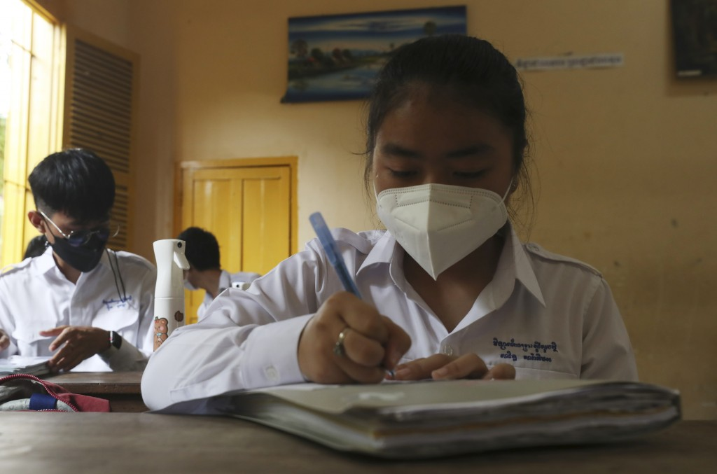 Students socially distance as they sit in a classroom at the Preah Sisowath high school in Phnom Penh, Cambodia, Wednesday, Sept. 15, 2021. The Munici...