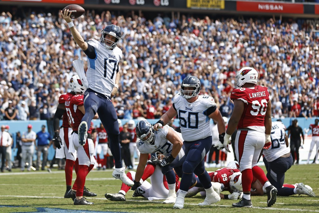 Tennessee Titans quarterback Ryan Tannehill (17) celebrates after scoring a touchdown against the Arizona Cardinals in the first half of an NFL footba...