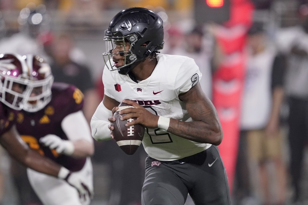 UNLV quarterback Doug Brumfield (2) looks to throw against Arizona State during the first half of an NCAA college football game, Saturday, Sept. 11, 2...