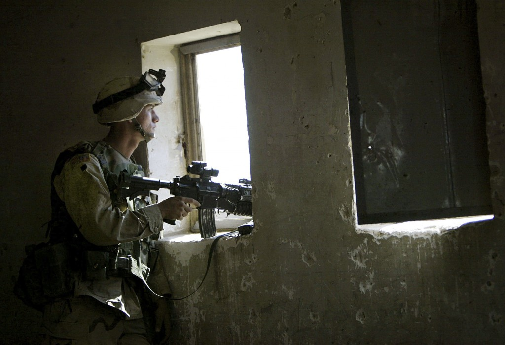 FILE - In this April 29, 2003, file photo, U.S. soldier mans a position from a primary school window in Fallujah, Iraq. The U.S. launched its invasion...